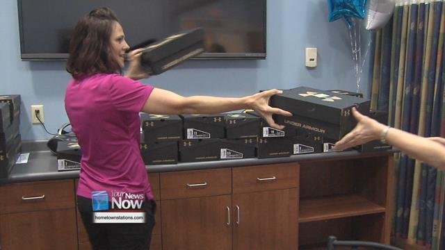Wednesdayafternoon, employees at all their health centers in the region received a new pair of Under Armour tennis shoes
