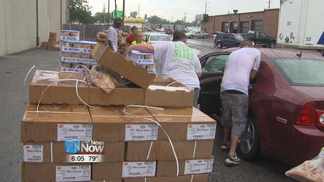 Volunteers and workers at the West Ohio Food Bank braved the rain Thursday afternoon to hand out food to those in need.