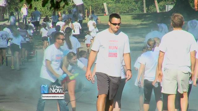 The Color Run involved people running or walking around a 5k path with colored powder being thrown at them at each kilometer.