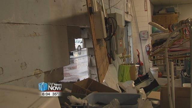 Shortly after 11 a.m. police and ambulance were called to the Neighborhood Relief Thrift Store after a blue van hit the side wall of the store.