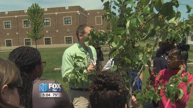 Students and community members gathered for a special ceremony Monday to dedicate ten fruit trees for the students at Lima South Magnet School.
