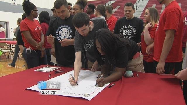 Graduating seniors who have committed to higher education or the military participated in the school's third annual academic signing event.