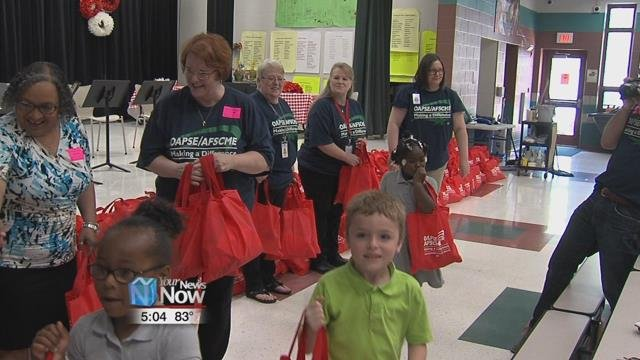 Local union volunteers stuffed the tote bags with snacks and meals and handed them out to students pre-kindergarten through fourth grade students in Lima City Schools.