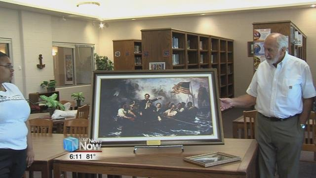 """Larry and Beverly Spees gave Perry Schools a large commodore painting of """"Perry""""."""
