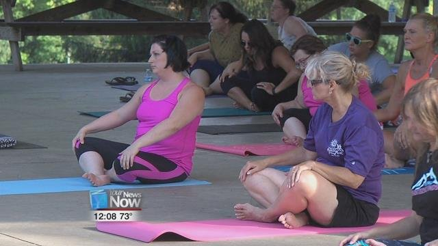 """The Northwest Ohio Rescue and Restore Coalition held their """"Darkness to Light"""" summer yoga program at Faurot Park."""
