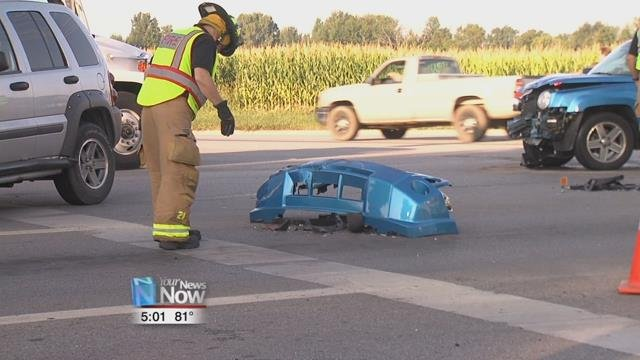 The Jeep collided with a blue vehicle, damaging both and sending one to the hospital with minor injuries.