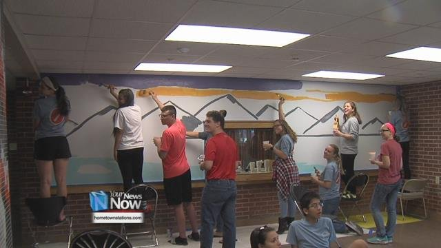 Student teams worked with the university's Physical Plant staff to paint murals in the halls and pull weeds outside.