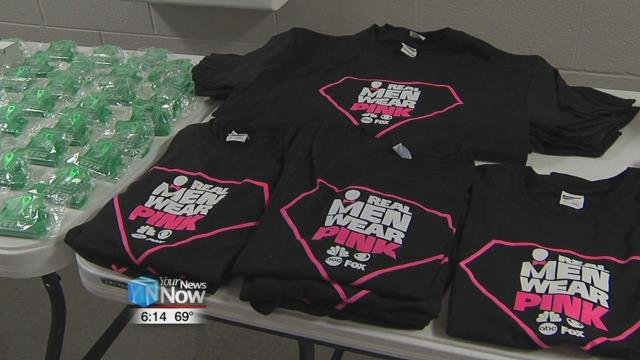 """He and volunteers were busy preparing the meal and selling raffle tickets along with """"Pink"""" merchandise."""