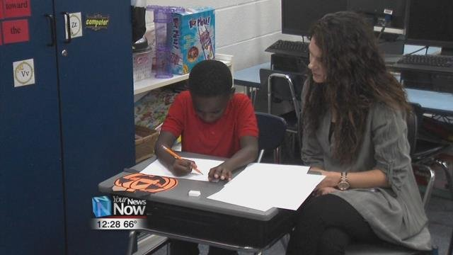 Second graders at Heritage Elementary had a class full of visitors by their side as they worked to improve their writing skills Wednesday morning.