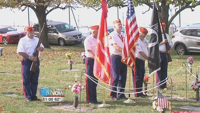 He was buried at sea and does not have a grave back in Lima,but now, a new Medal of Honor memorial marker is placed nearby his parents' grave - a first for Allen County.