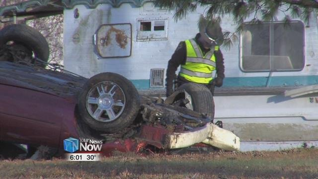 The car went airborne, hitting several objects, and flipped multiple times before coming to rest.