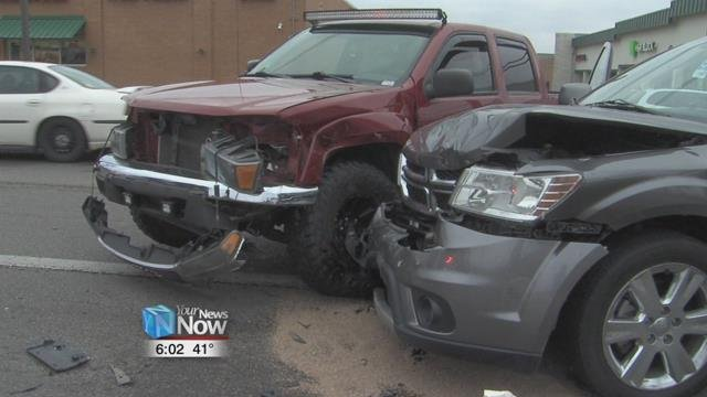 The gray minivan was traveling southbound on Cable when the burgundy pickup truck came into their lane.