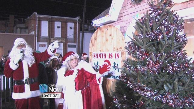 Santa and Mrs. Claus lit up their Christmas treeand opened their doors for kids to meet St. Nick.