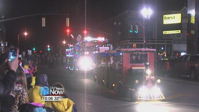 People lined the streets to see the parade featuring police and fire trucks, and dozens of Christmas helpers.