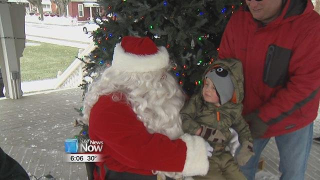 Families braved the cold and were lined up in Minster Machine's Centennial Park to see Santa and Mrs. Claus