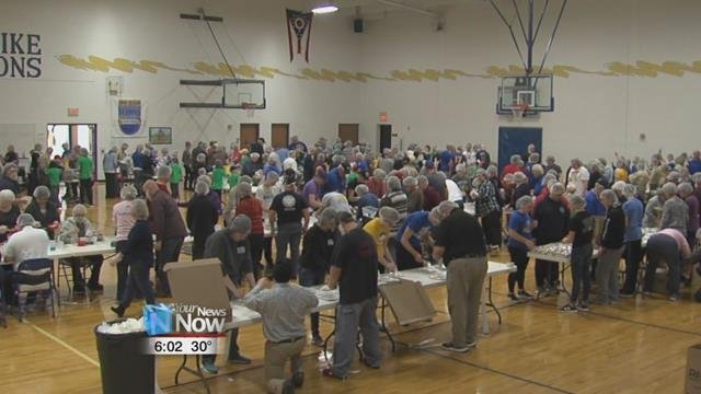 Hundreds of people showed up to Delphos St. John's on Sunday to put together boxes of meal bags for the organization Rise Against Hunger.