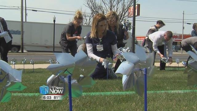 For the 14th year, hundreds of blue pinwheels dot the lawn in front of Lima Memorial's ER windows.