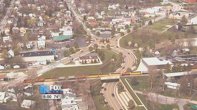 The roadway where Elm Street meets the railroad tracks will be lowered 20 feet to allow traffic to flow continuously.