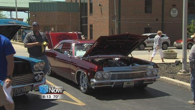 There were twenty cars on display at the annual event, ranging from classic to military vehicles.