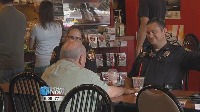 """Members from the Findlay Police Department and the Hancock County Sheriff's Office were at Coffee Amici Saturdaymorning for their """"Coffee With a Cop"""" event."""
