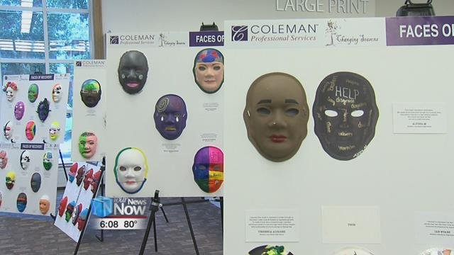 The display features masks that have been painted by people struggling with mental health issues and addiction, as well as different members of the community and students from Lima schools.