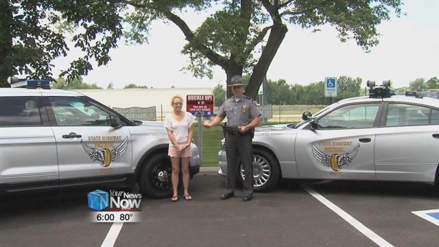 """Ohio State Highway Patrol recognized Kristie Hayhurst on Thursday with the """"Saved by the Belt"""" award."""