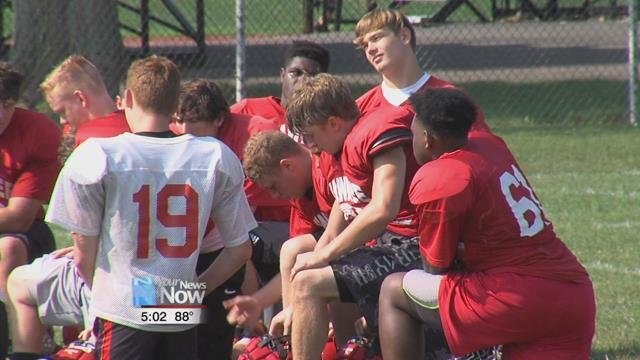 Despite the heat, the football team at Shawnee High School is outside preparing for their upcoming season.