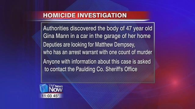 Authorities discovered the body of 47 year old Gina Mann in a car in the garage of her home in Paulding.