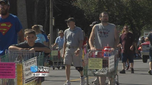 "Volunteers with the Churches United Pantry, known as ""CUP"", will be pushing grocery carts in the Allen County Fair parade this Sunday at 2 p.m."