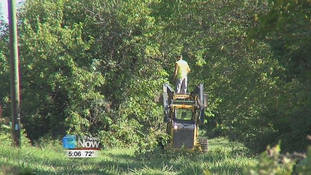Crews were seen Tuesday, beginning at Old Acadia Park, clearing tree branches out of the way of the path.