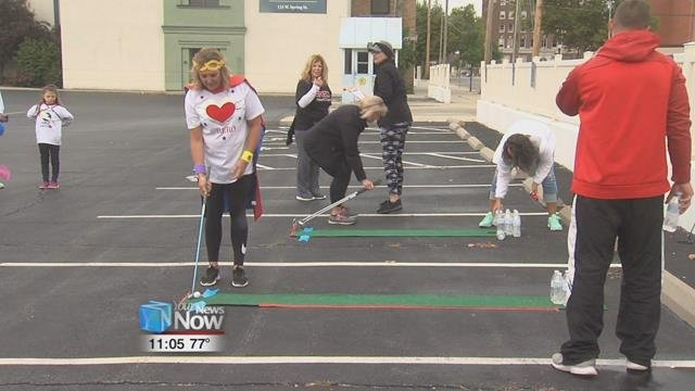 Teams went around to different obstacles in the downtown area playing games like tic-tac-toe, human ring tosses, and mini golf.