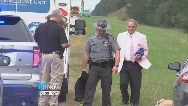 The Ohio State Highway Patrol and the Ohio Bureau of Criminal Identification and Investigation, searching the grassy area around mile marker 151 in the southbound lane of I-75.