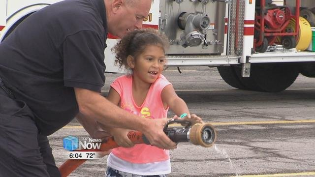 The young students got a chance to seethree trucks up close and even got a chance to work a fire hose.