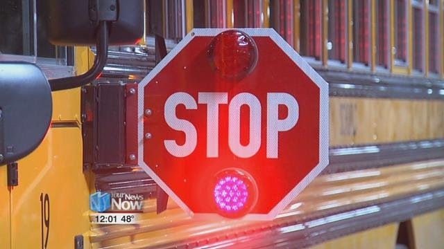 Motorists are required to stop at least ten feet from a bus when the bus is loading or unloading children while having its stop sign out.