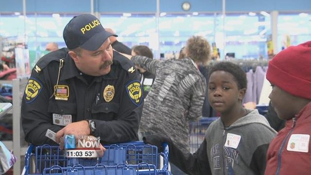 79 kids traveled to Meijer from the Fraternal Order of Police Lima Lodge where theywere paired with an officer so that they couldshop for both Christmas presents andessentials.