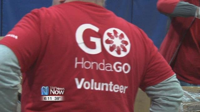 25 Employees from Honda Transmission Manufacturing and Honda of America Manufacturing helped out food bank put on a food distribution event.